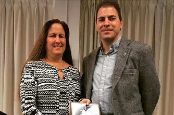 Carol Marbin Miller and Executive Associate Dean Spiro Kiousis. Marbin Miller also accepted the award on behalf of her colleague on the project Audra D.S. Burch.